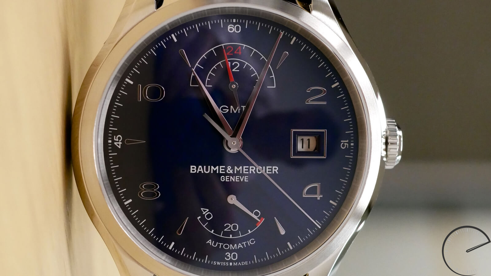 Baume et Mercier GMT Power Reserve - affordable timepiece with blue sunray dial